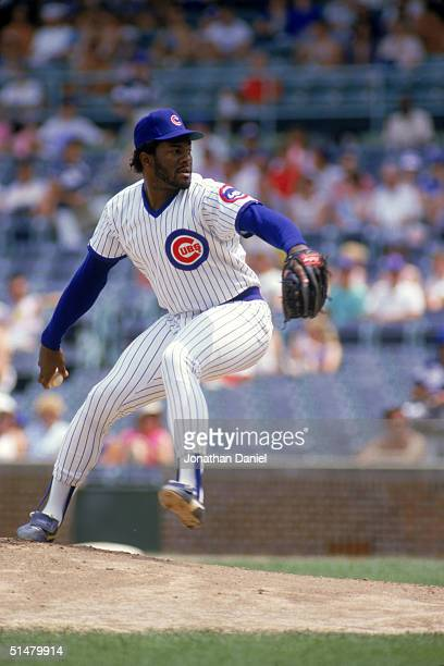 Lee Smith of the Chicago Cubs winds back to pitch during a June 1987 season game at Wrigley Field in Chicago Illinois