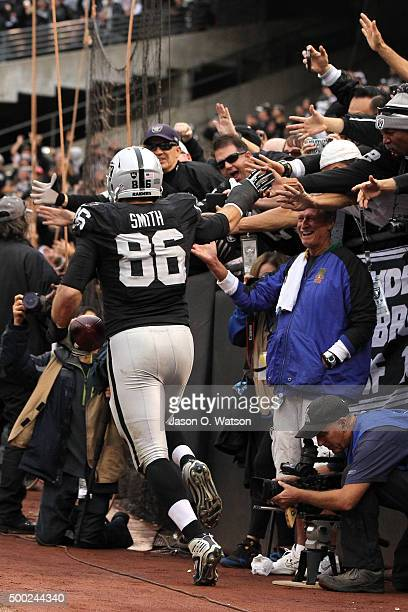 Lee Smith of the Oakland Raiders celebrates after scoring on a 5yard touchdown pass from Derek Carr during their NFL game against the Kansas City...