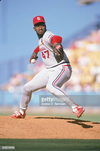 Lee Smith of the St Louis Cardinals pitches against the Los Angeles Dodgers during a game in the 1990 season at Dodger Stadium in Los Angeles...