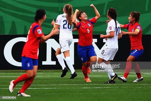 Lee Sodam of Korea Republic celebrates her team's first goal during the FIFA U20 Women's World Cup Canada 2014 group C match between England and...