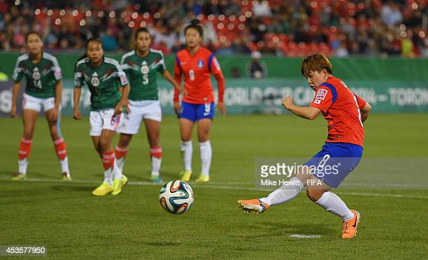 Lee Sodam of Korea Republic scores from the penalty spot during the FIFA U20 Women's World Cup Canada 2014 Group D match between Korea Republic and...