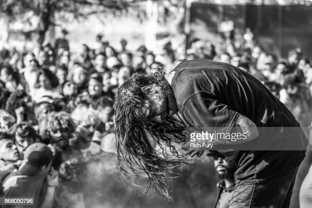 Lee Spielman of Trash Talk performs with a fan on the Flog Stage during day 2 of Camp Flog Gnaw Carnival 2017 at Exposition Park on October 29 2017...