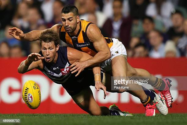 Lee Spurr of the Dockers and Paul Puopolo of the Hawks contest for the ball during the AFL First Preliminary Final match between the Fremantle...