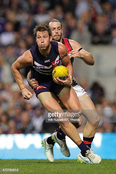 Lee Spurr of the Dockers is tackled by Travis Colyer of the Bombers during the round six AFL match between the Fremantle Dockers and the Essendon...