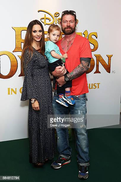 Lee Stafford with JessicaJane Clement and son Angel attend the UK gala screening of Pete's Dragon at Ham Yard Hotel on July 31 2016 in London England