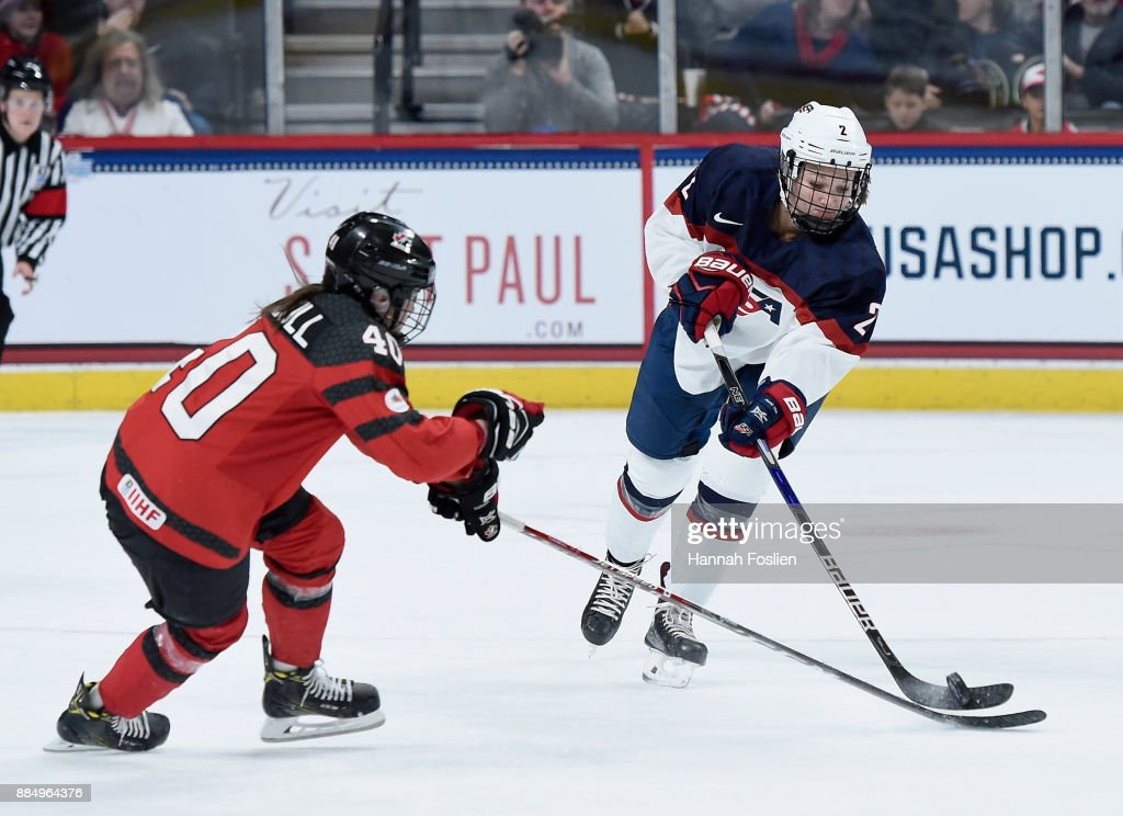 Lee Stecklein #2 of the United States passes the puck against Blayre Turnbull #40 of Canada during the second period of the game on December 3, 2017 at Xcel Energy Center in St Paul, Minnesota. Canada defeated the United States 2-1 in overtime.