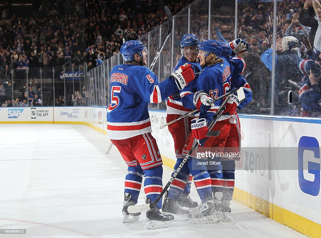 Lee Stempniak #12, Dan Girardi #5, Carl Hagelin #62 and Marc Staal #18 of the New York Rangers celebrate after a late third period goal against the Arizona Coyotes at Madison Square Garden on February 26, 2015 in New York City.