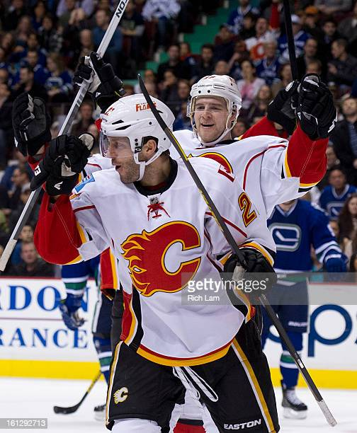 Lee Stempniak of the Calgary Flames celebrates with Matt Stajan after scoring a goal against the Vancouver Canucks during the first period in NHL...