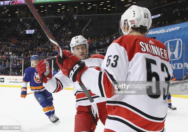 Lee Stempniak of the Carolina Hurricanes scores a goal at 444 of the first period aginst the New York Islanders at the Barclays Center on March 18...