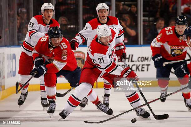 Lee Stempniak of the Carolina Hurricanes skates with the puck against Aleksander Barkov of the Florida Panthers at the BBT Center on April 2 2018 in...