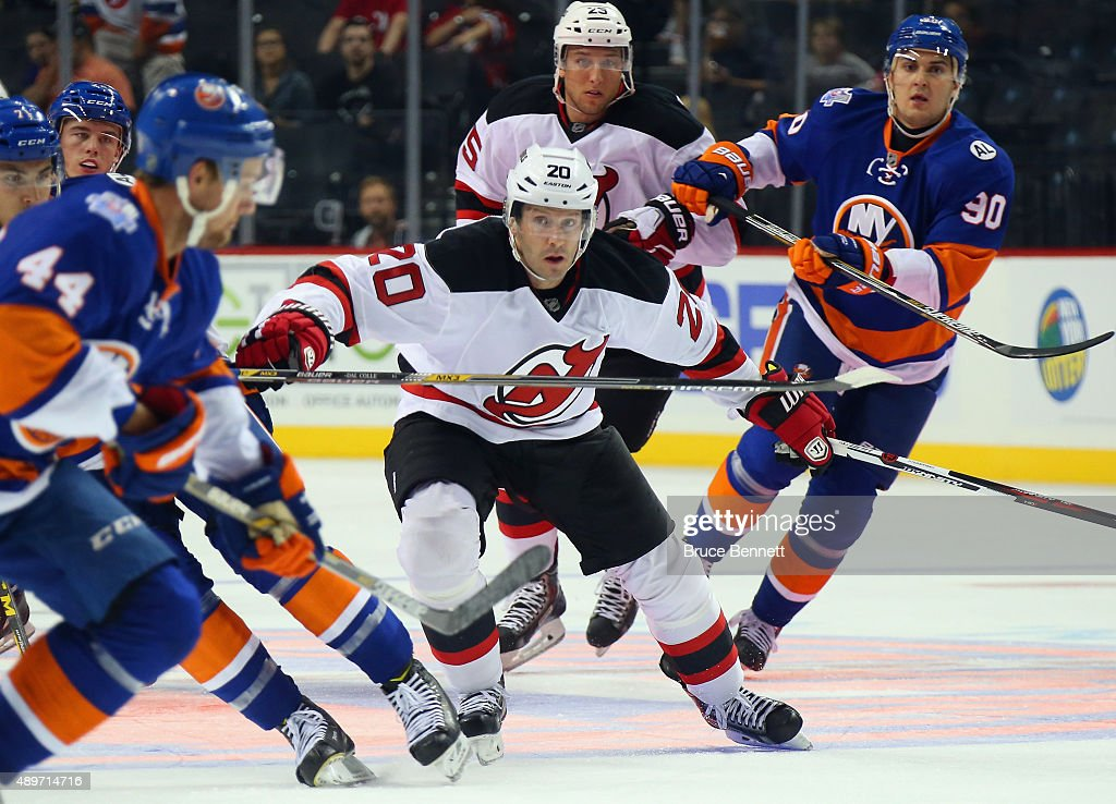 Lee Stempniak #20 of the New Jersey Devils skates against the New York Islanders at the Barclays Center on September 23, 2015 in the Brooklyn borough of New York City. The Islanders defeated the Devils 2-1.