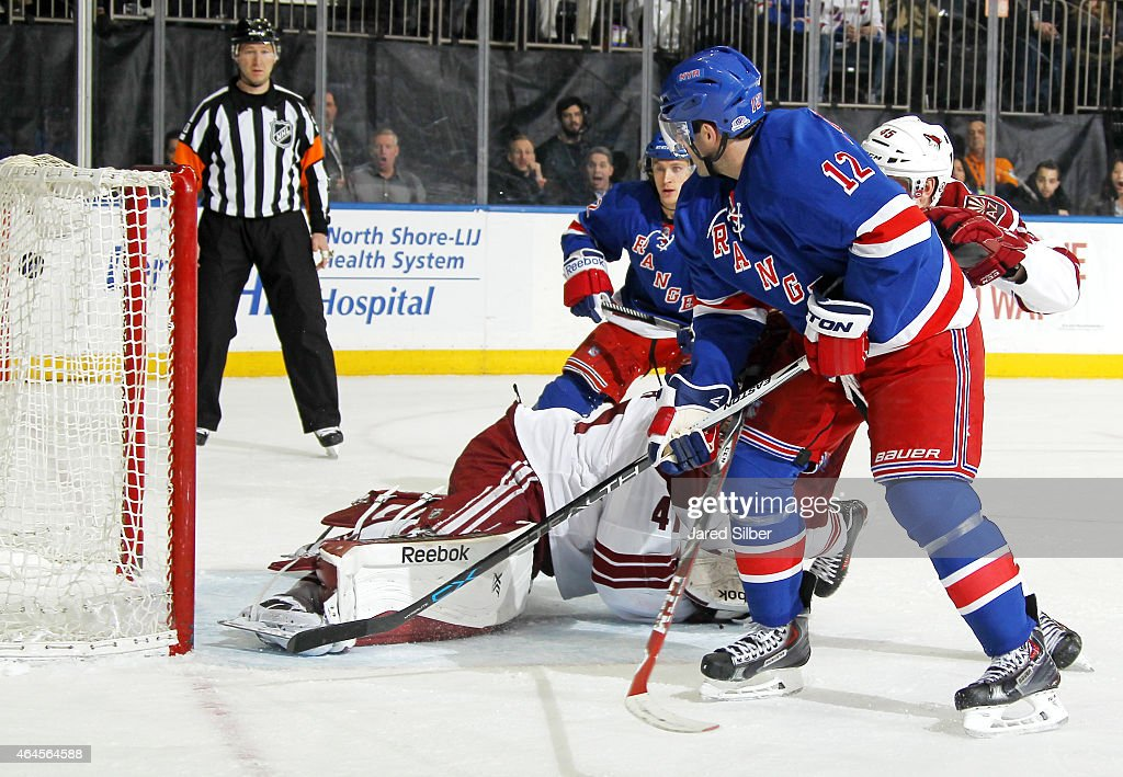 Lee Stempniak #12 of the New York Rangers lifts the puck over the pad of Mike Smith #41 of the Arizona Coyotes for a goal late in the third period at Madison Square Garden on February 26, 2015 in New York City.