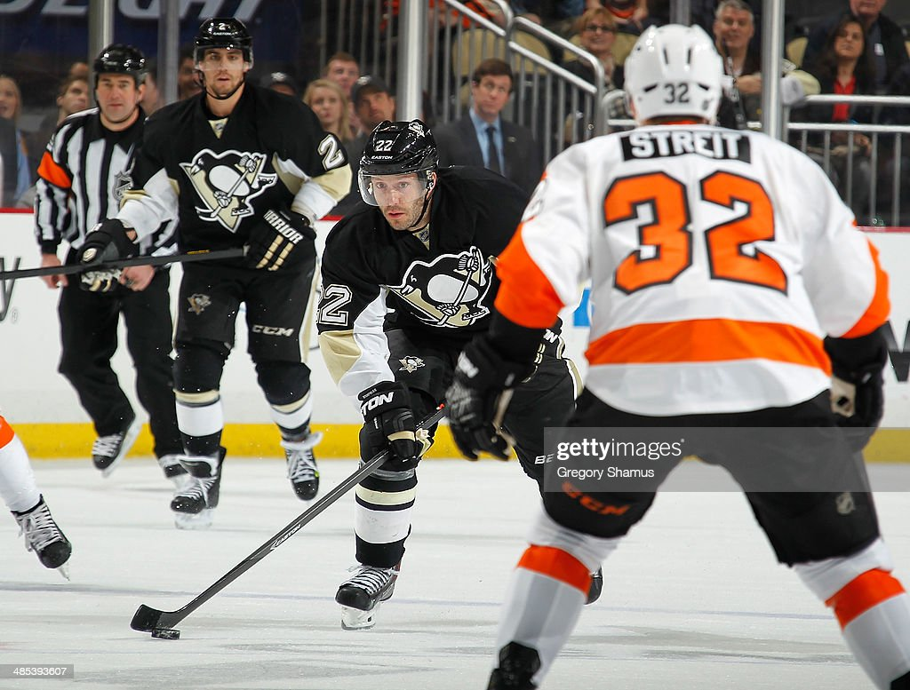 Lee Stempniak #22 of the Pittsburgh Penguins moves the puck against the Philadelphia Flyers on April 12, 2014 at Consol Energy Center in Pittsburgh, Pennsylvania.
