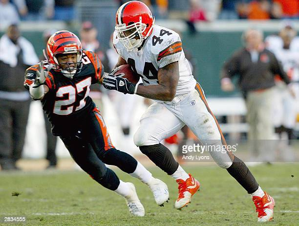 Lee Suggs of the Cleveland Browns runs for a 25 yard touchdown while chased by Artrell Hawkins of the Cincinnati Bengals on December 28 2003 at Paul...