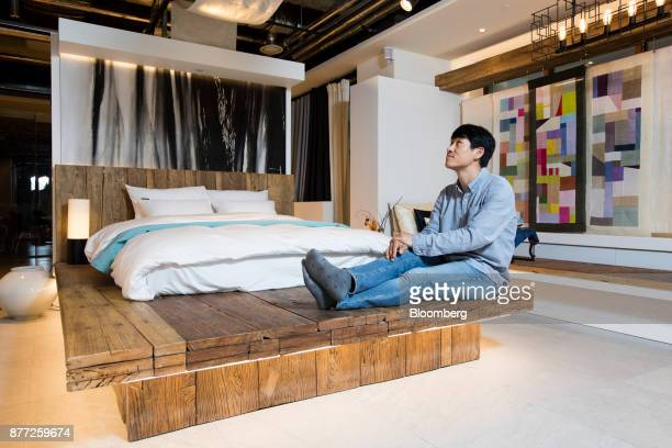 Lee Sujin chief executive officer of Yanolja Co poses for a photograph inside a mockup motel room at the company's headquarters in Seoul South Korea...