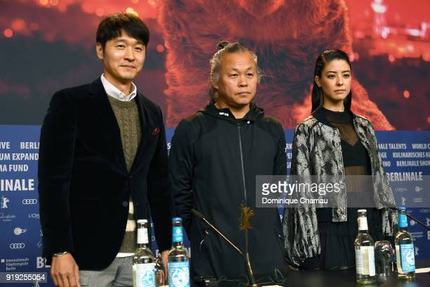 Lee Sung-jae, Kim Ki-duk and Mina Fujii attend the 'Human, Space, Time and Human' press conference during the 68th Berlinale International Film...