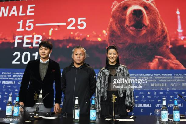 Lee Sung-jae, Kim Ki-duk and Mina Fujii pose at the 'Human, Space, Time and Human' press conference during the 68th Berlinale International Film...