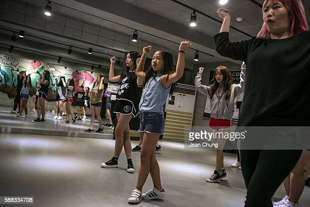 Lee Taerim practices dance moves by a KPop girl band Girlfriends along with young women at Def Dance School on August 10 2016 in Seoul South Korea...