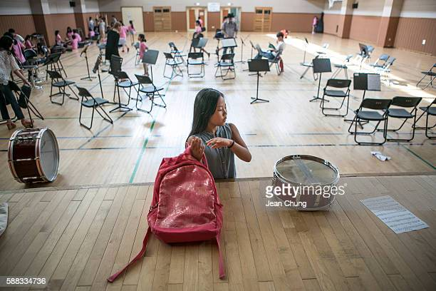 Lee Taerim readies to go to a math school after finishing a practice at a school orchestra as an afterschool program on August 10 2016 in Seoul South...