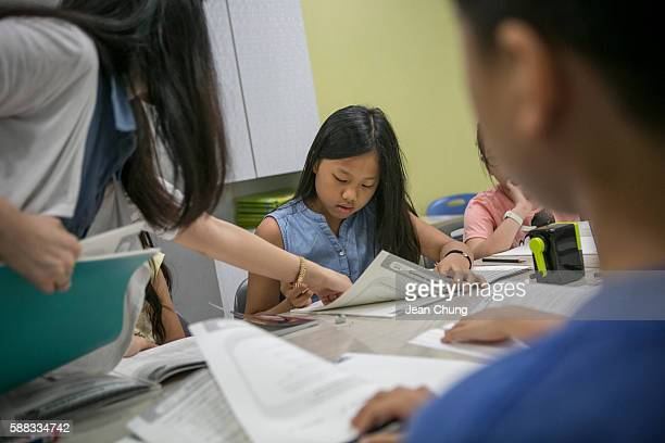Lee Taerim takes an Englishlanguage test at paedeaplus English school on August 10 2016 in Seoul South Korea Lee a class president who also excels in...
