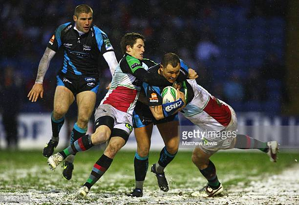Lee Thomas of Sale is tackled by Tom Williams of Harlequins during the Heineken Cup match between Sale Sharks and Harlequins at Edgeley Park on...