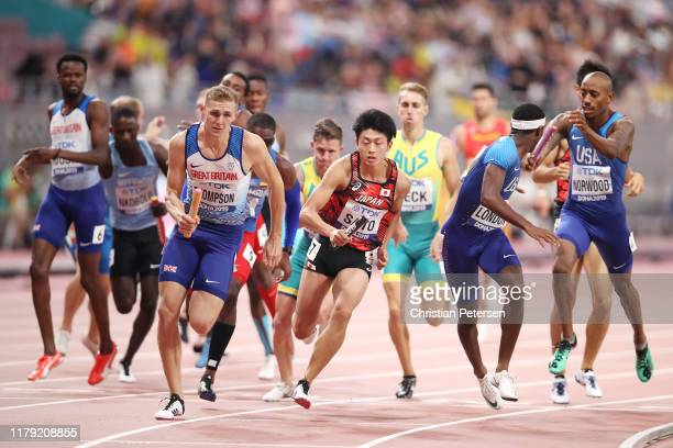 Lee Thompson of Great Britain and Kentaro Sato of Japan compete in the Men's 4x400 metres relay heats during day nine of 17th IAAF World Athletics...