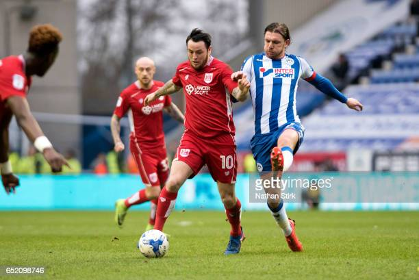 Lee Tomlin of Bristol City and Alex Gilbey of Wigan Athletic in action during the Sky Bet Championship match between Wigan Athletic and Bristol City...