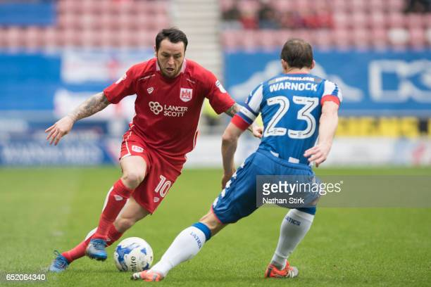 Lee Tomlin of Bristol City and Stephen Warnock of Wigan Athletic in action during the Sky Bet Championship match between Wigan Athletic and Bristol...