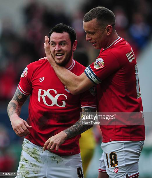 Lee Tomlin of Bristol City celebrates his sides second goal with Aaron Wilbraham of Bristol City during the Sky Bet Championship match between...