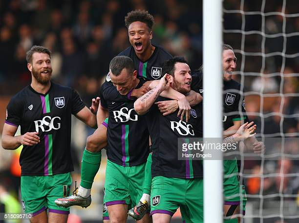 Lee Tomlin of Bristol City celebrates with teammates after scoring the winning goal from a freekick during the Sky Bet Championship match between...