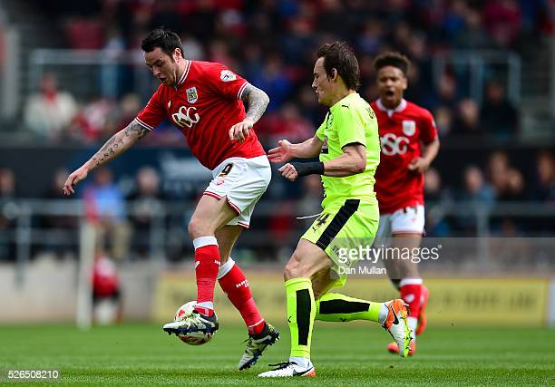 Lee Tomlin of Bristol City holds off Dean Whitehead of Huddersfield Town during the Sky Bet Championship match between Bristol City and Huddersfield...