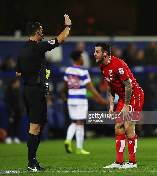 Lee Tomlin of Bristol City is showen a yellow card during the Sky Bet Championship match between Queens Park Rangers and Bristol City at Loftus Road...