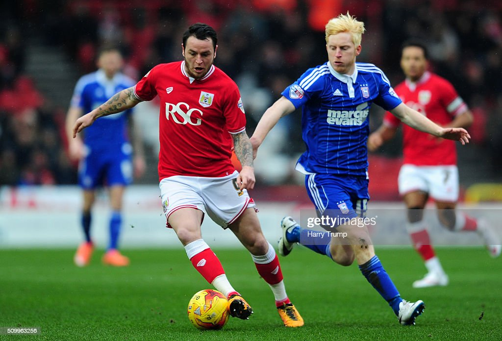 Lee Tomlin of Bristol City is tackled by Ben Pringle of Ipswich Town during the Sky Bet Championship match between Bristol City and Ipswich Town at Ashton Gate on February 13, 2016 in Bristol, England.