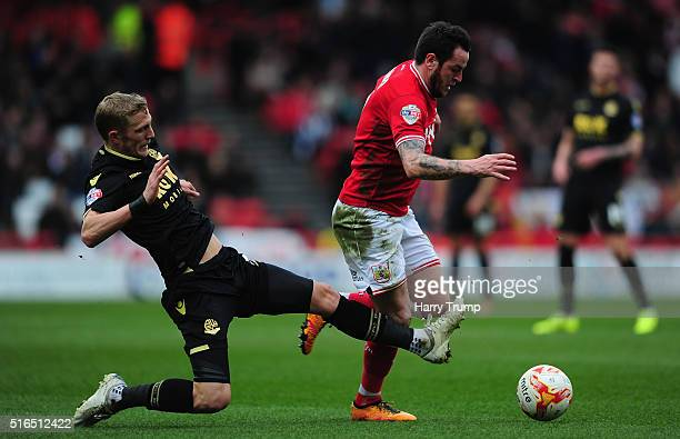 Lee Tomlin of Bristol City is tackled by Dean Moxey of Bolton Wanderers during the Sky Bet Championship match between Bristol City and Bolton...