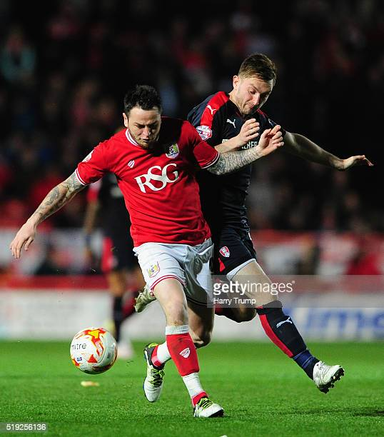 Lee Tomlin of Bristol City is tackled by Lee Frecklington during the Sky Bet Championship match between Bristol City and Rotherham United at Ashton...