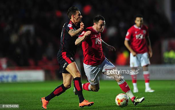 Lee Tomlin of Bristol City is tackled by Matt Derbyshire of Rotherham United during the Sky Bet Championship match between Bristol City and Rotherham...