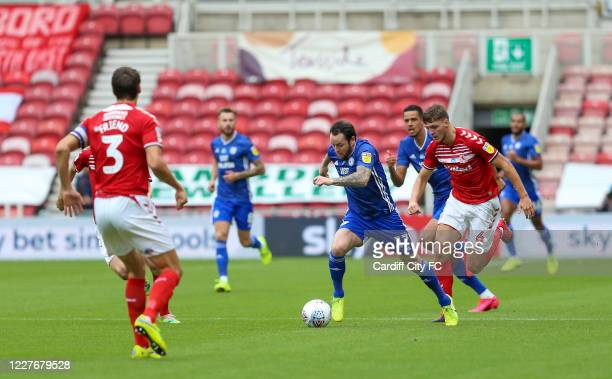 Lee Tomlin of Cardiff City FC and Dael Fry of Middlesbrough during the Sky Bet Championship match between Middlesbrough and Cardiff City at Riverside...