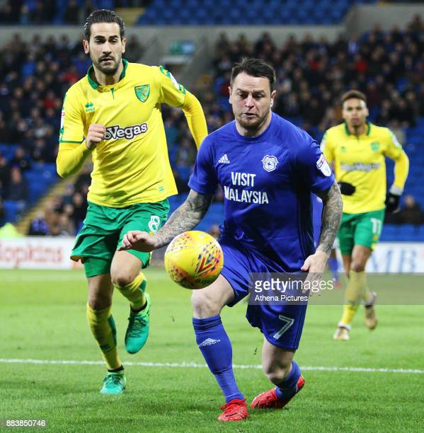 Lee Tomlin of Cardiff City is marked by Mario Vrancic of Norwich City during the Sky Bet Championship match between Cardiff City and Norwich City at...