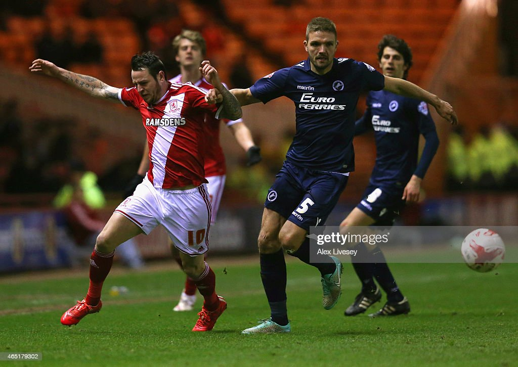 Lee Tomlin of Middlesbrough and Jos Hooiveld of Millwall compete for the ball during the Sky Bet Championship match between Middlesbrough and Millwall at Riverside Stadium on March 3, 2015 in Middlesbrough, England.