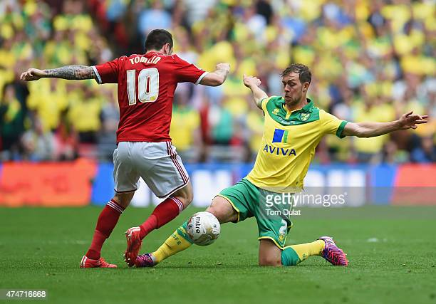 Lee Tomlin of Middlesbrough is tackled by Steven Whittaker of Norwich City during the Sky Bet Championship Playoff Final between Middlesbrough and...