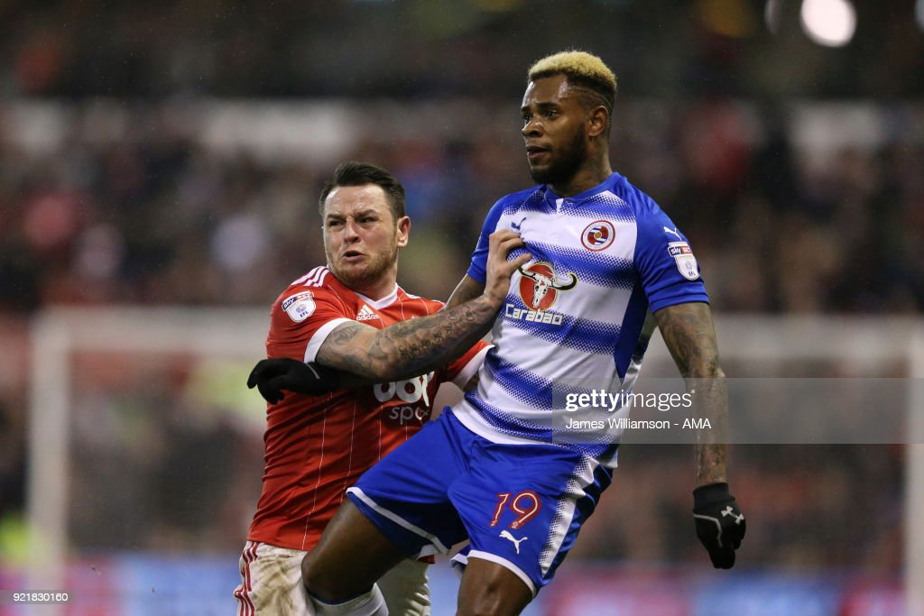 Lee Tomlin of Nottingham Forest and Leandro Bacuna of Reading during the Sky Bet Championship match between Nottingham Forest and Reading at City Ground on February 20, 2018 in Nottingham, England.