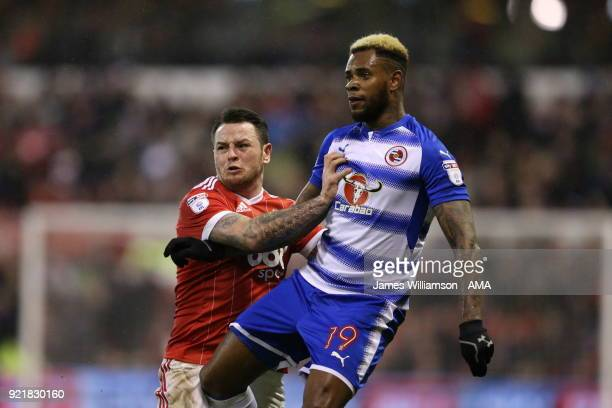 Lee Tomlin of Nottingham Forest and Leandro Bacuna of Reading during the Sky Bet Championship match between Nottingham Forest and Reading at City...