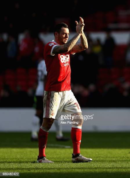 Lee Tomlin of Nottingham Forest applauds fans following the Sky Bet Championship match between Nottingham Forest and Derby County at City Ground on...
