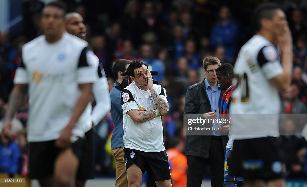 Lee Tomlin of Peterborough looks dejected after they are relegated during the npower Championship match between Crystal Palace and Peterborough United at Selhurst Park on May 04, 2013 in London, England.
