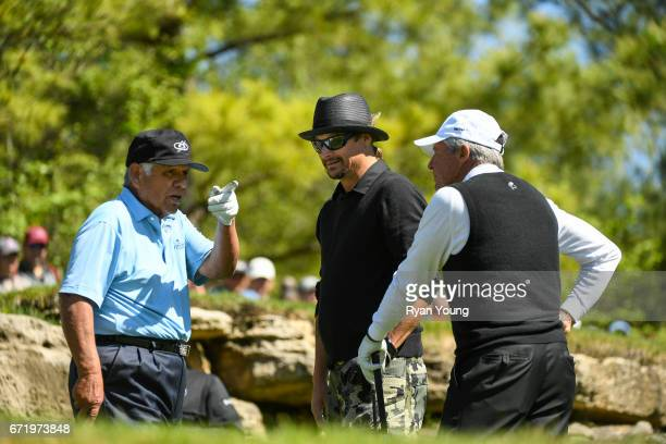 Lee Trevino Gary Player and Kid Rock talk on the fifth hole during the Legends of Golf Skins Shooutout during the PGA TOUR Champions Bass Pro Shops...