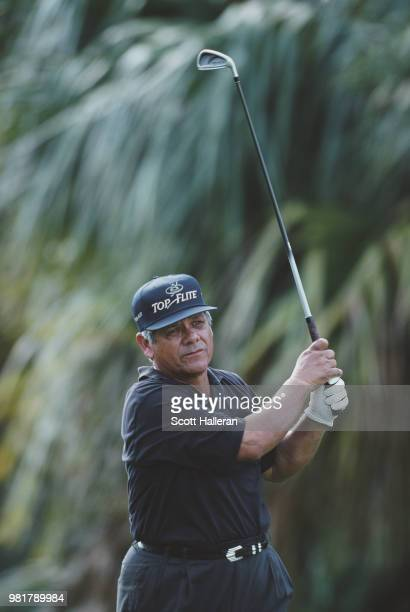 Lee Trevino of the United States follows his iron shot during the Senior PGA Championship on 16 April 2000 at the PGA National Golf Club Palm Beach...