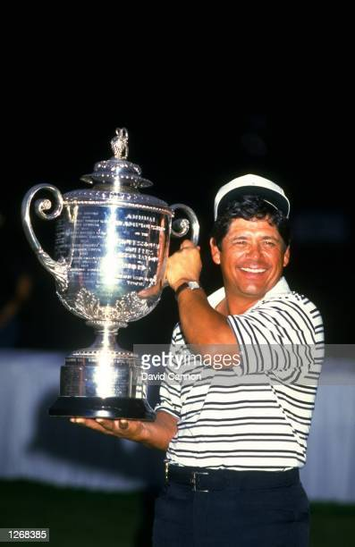 Lee Trevino of the USA holds the trophy aloft after the USPGA Championships at the Shoal Creek Country Club in Birmingham Alabama USA Trevino won the...