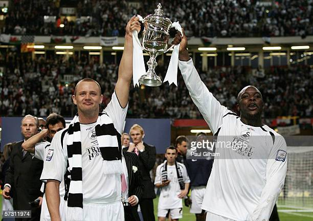 Lee Trundle and Adebayo Akinfenwa of Swansea City celebrate after their victory during The Football League Trophy Final match between Carlisle United...
