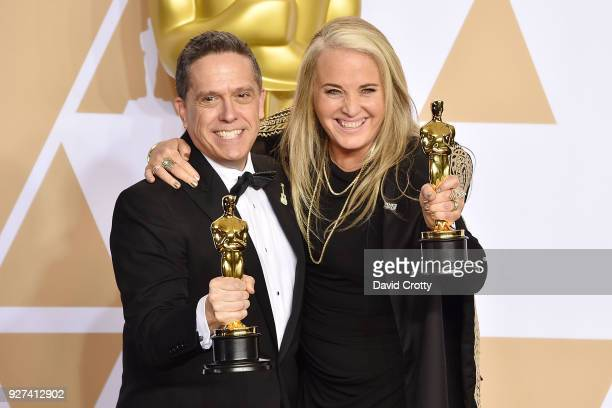Lee Unkrich and Darla K Anderson attend the 90th Annual Academy Awards Press Room on March 4 2018 in Hollywood California