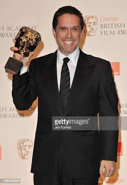 Lee Unkrichposes with the award for Animated Film for the film Toy Story 3 during the 2011 Orange British Academy Film Awards at The Royal Opera...